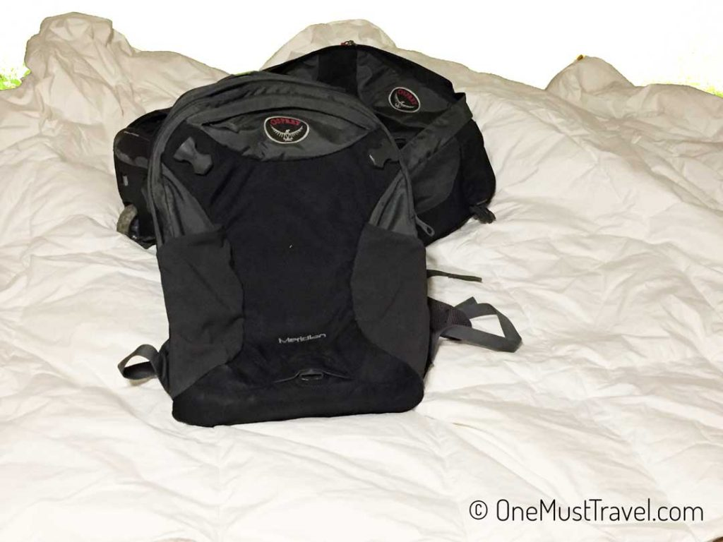 The Osprey Meridian 22 with day pack detached.